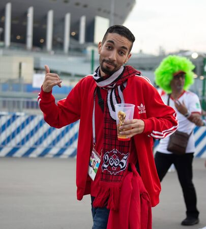 Disappointed football fan of Morocco after FIFA world cup match with Iran in St Petersburg Russia 2018 June 15. Loss 0 - 1. The man shows expression like 'well, it happens' Editorial