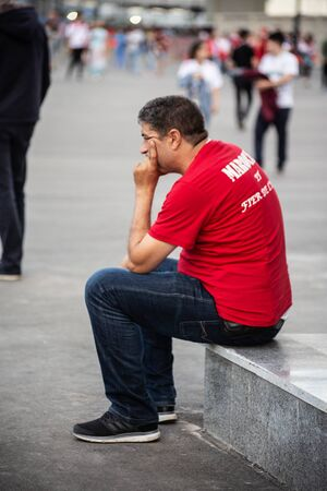 Disappointed football fan of Morocco after FIFA world cup match with Iran in St Petersburg Russia 2018 June 15. Loss 0 - 1. The man is sitting sadly