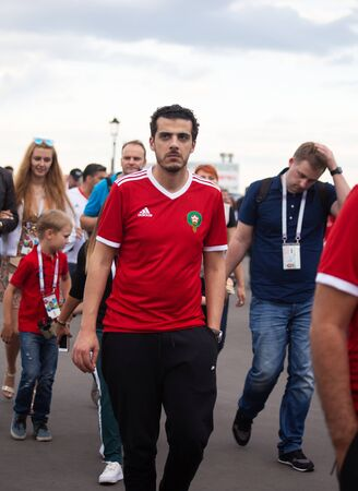 Disappointed football fans of Morocco after FIFA world cup match with Iran in St Petersburg Russia 2018 June 15. Loss 0 - 1. The man is walking with angry expression