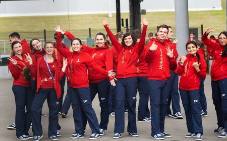 A group of volunteers at 2018 FIFA world cup in red jackets is dancing. Saint Petersburg, Russia Editorial
