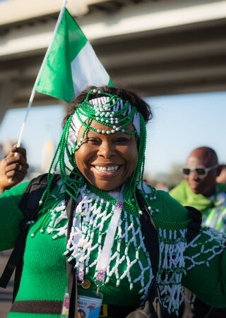 A woman football fan of Nigeria in national suit is smiling. Before a dramatic game with Argentina June 26th 2018 at FIFA world cup in St Petersburg, Russia Editorial