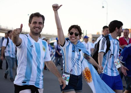 Football fans of Argentina before a game with Nigeria on June 26th 2018 at FIFA world cup in St Petersburg, Russia. Two men and a woman Editorial