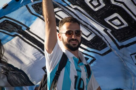 A football fan of Argentina before a game with Nigeria on June 26th 2018 at FIFA world cup in St Petersburg, Russia. A man in glasses with a beard. Blue and white colors of Argentinian flag