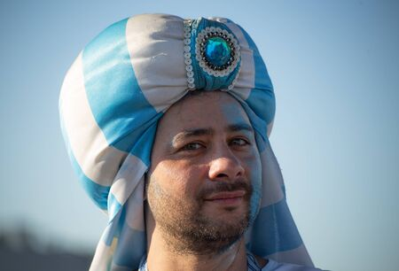 A football fan of Argentina before a game with Nigeria on June 26th 2018 at FIFA world cup in St Petersburg, Russia. A man in a head hugger in blue and white colors of an Argentinian flag Editorial