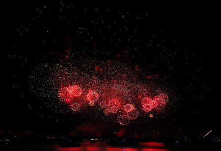 A red firework display in the night sky over river Neva at Scarlet Sails festivity in Saint Petersburg ,Russia
