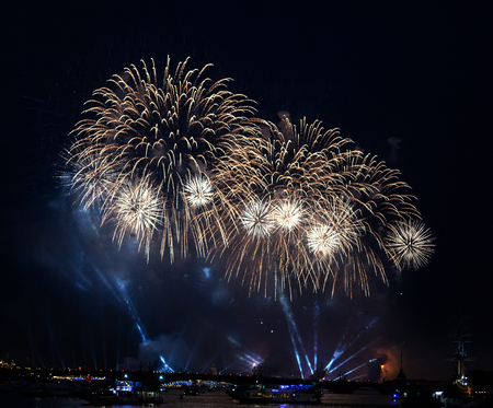A white firework display in the night sky over Trinity bridge on the river Neva at Scarlet Sails festivity in Saint Petersburg ,Russia