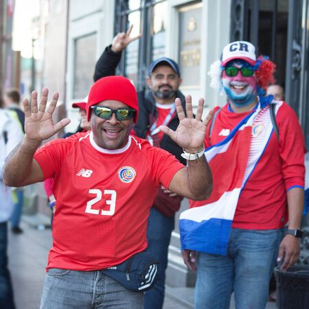 Football fans of Costa Rica at FIFA world cup. A happy man is running to the camera. June 2018, St Petersburg, Russia
