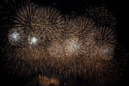 A firework display in the night sky at Scarlet Sails festivity in Saint Petersburg ,Russia. Traces of multiple exploding particles are seen Stok Fotoğraf