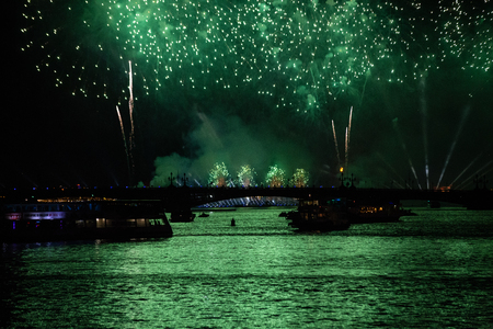 A green firework display in the night sky over Trinity bridge across river Neva at Scarlet Sails festivity in Saint Petersburg ,Russia