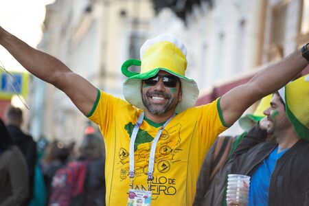 A still happy football fan of Brasil in a yellow and green hat raised his arms. St. Petersburg, Russia. July 2018, FIFA world cup.