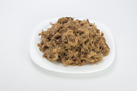chicharrones: Duvan chicharrones de cerdo cvarci en la placa aislados en blanco