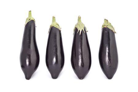 Young fresh black eggplants isolated on white photo