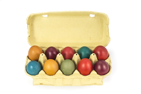 egg box: Easter eggs in cardboard egg box on white background