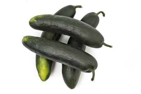 cuke: Fresh organic cucumbers isolated on white