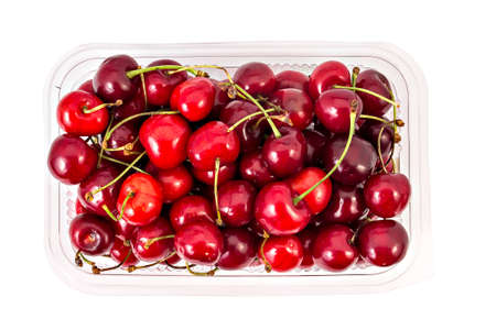 pulpy: Box or punnet of fresh ripe organic cherries isolated on white background