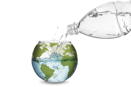 Water spilled from bottle made the wave in globe bowl. Environmental protection concept, global warming. Stock Photo