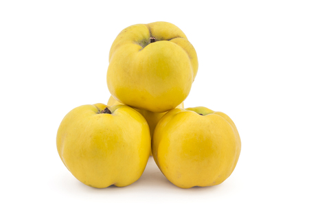quinces: Pile of fresh ripe yellow quinces isolated on white background