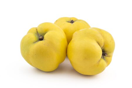 quinces: Three fresh ripe yellow quinces isolated on white background Stock Photo