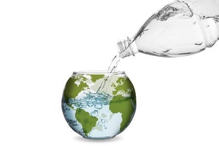 global warming: Water spilled from bottle made the wave in globe bowl. Environmental protection concept, global warming