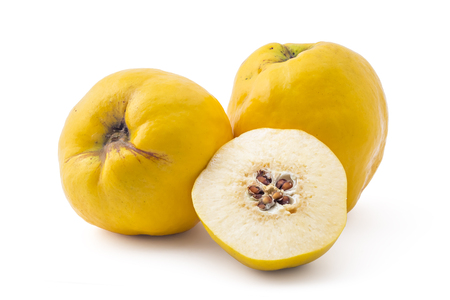 quinces: Fresh ripe yellow quinces, one cutted on half, isolated on white background