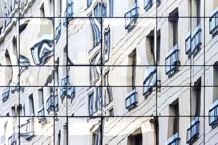 imperialism: Twisted reflection of a business object in the glass building