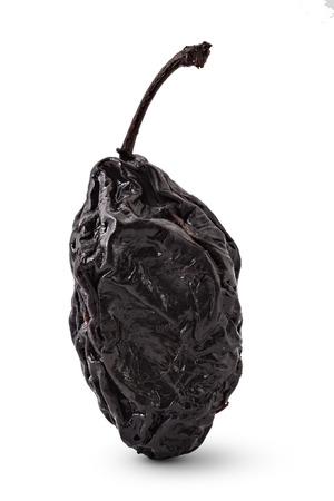 ciruela pasa: Raw organic prune, dried plum, isolated on a white background. Closeup Foto de archivo