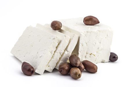 Sliced fresh white cheese from cows milk with kalamata black olives on white background