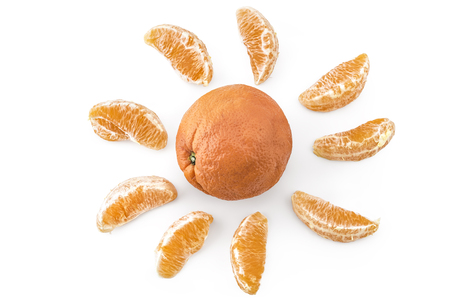 cantle: Fresh ripe organic oranges arranged in the form of the sun isolated on white background