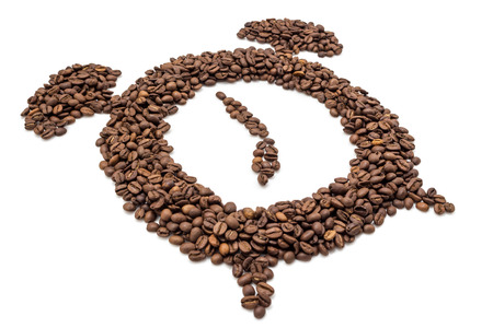 Alarm clock of coffee grains isolated on white background. Coffee beans in clock symbol pointed at seven oclock