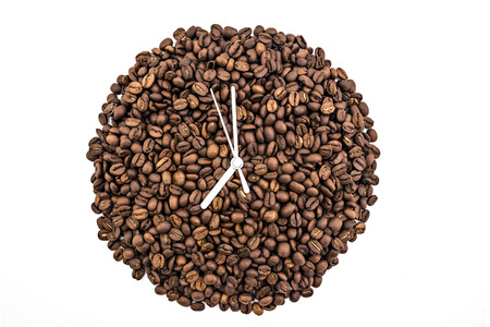 Clock of coffee grains isolated on white background. Clock pointed at seven oclock