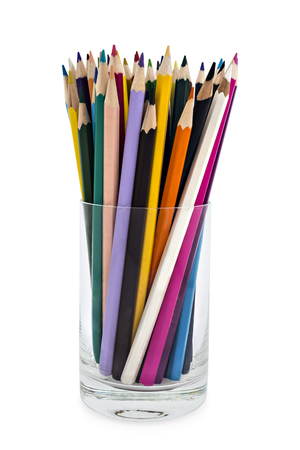 A stack of colored pencils of various color in a glass on white background Stock Photo