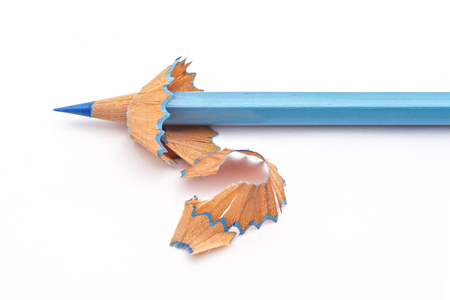 Blue color pencil has been sharpened, with pencil shavings on white background Stock Photo