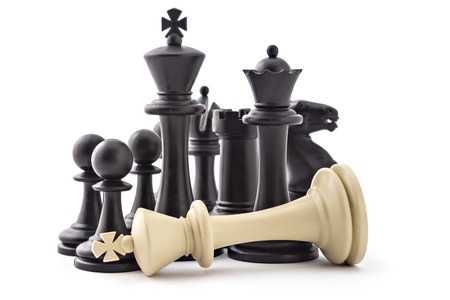 Chess business concept, leader & success. Black figures and defeated white king