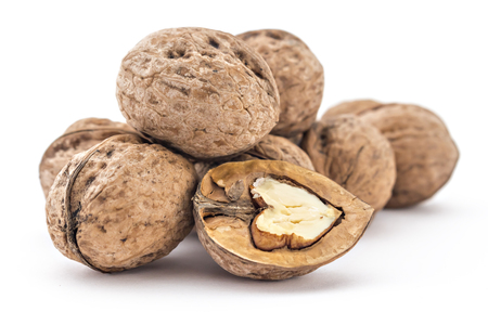 Assortment of dried walnuts. Walnut and a cracked walnut isolated on the white background. Splintered walnut with heart-shaped core