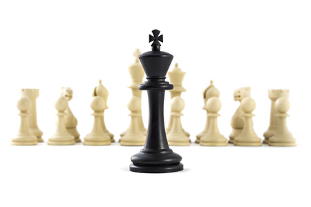 Chess business concept, leader & success. Black king in front of set of white figures Stock Photo