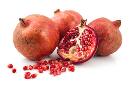 cutted: Bunch of fresh raw red pomegranates, one cutted and peeled, isolated on a white background Stock Photo