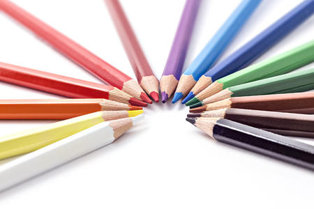 Colored pencils tops of various color in a row on white background 版權商用圖片