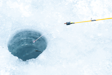 Ice-hole and fishing rod for winter fishing.