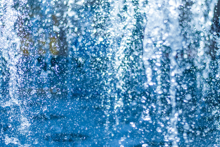 The gush of water of a fountain. Splash of water in the fountain, abstract image. bokeh of blue water Фото со стока - 88757681