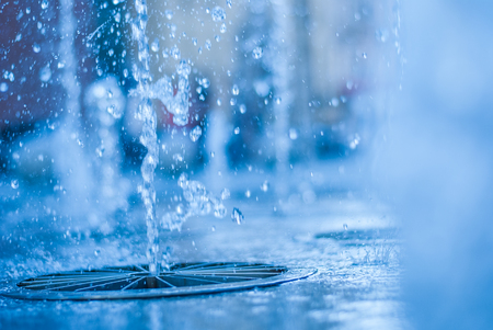 The gush of water of a fountain. Splash of water in the fountain, abstract image. bokeh of blue water Stock Photo