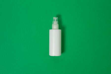 Cosmetics, Moisturizer, Bottle. Blank plastic cosmetics bottle isolated on green background with copy space Stockfoto