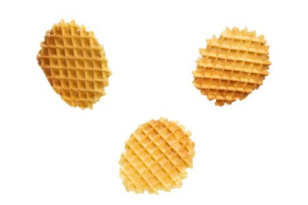 Set Round yellow waffles in different positions of flight on a white background. Round Belgian waffles isolated on white background. 免版税图像