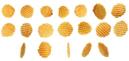 Set Round yellow waffles in different positions of flight on a white background. Round Belgian waffles isolated on white background.