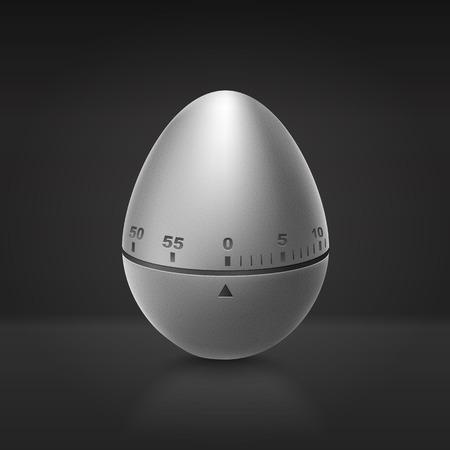 timescale: Kitchen aluminium timer on dark background. Pomodoro technique.