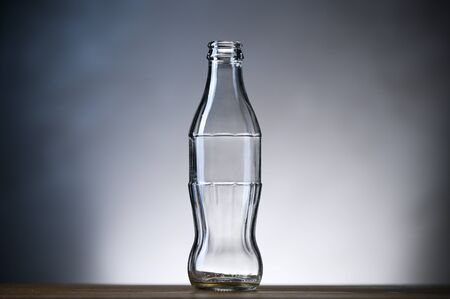 Empty glass bottle for reusable drinks.
