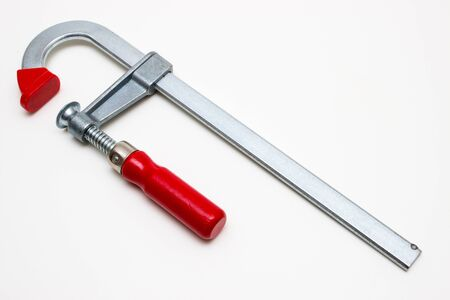 vice grip: clamp with red handle isolated on white background