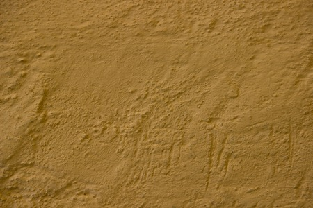 Beige yellow old grunge wall texture, concrete cement background Stock Photo