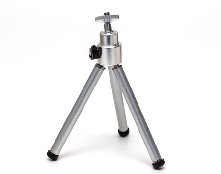 chrome base: Miniature metal tripod isolated Stock Photo