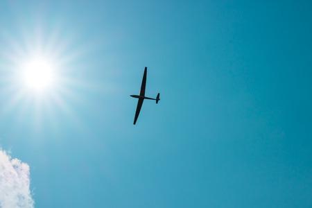 The glider gliding in the blue sky, glider flight Stock Photo