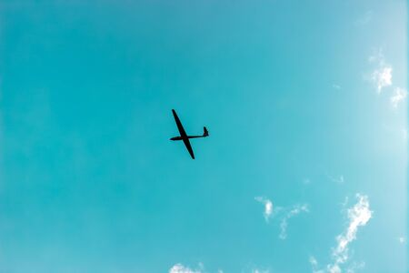 The glider gliding in the blue sky Stock Photo